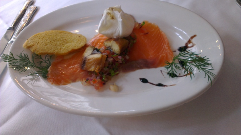 Smoked salmon, mackerel, and a poached egg (yes that is a poached egg and not cream cheese!).
