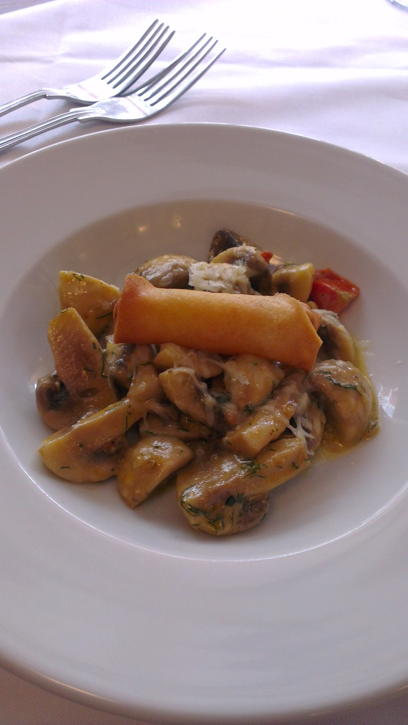 Sauteed mushrooms with a spring roll . A strange combination but it works!